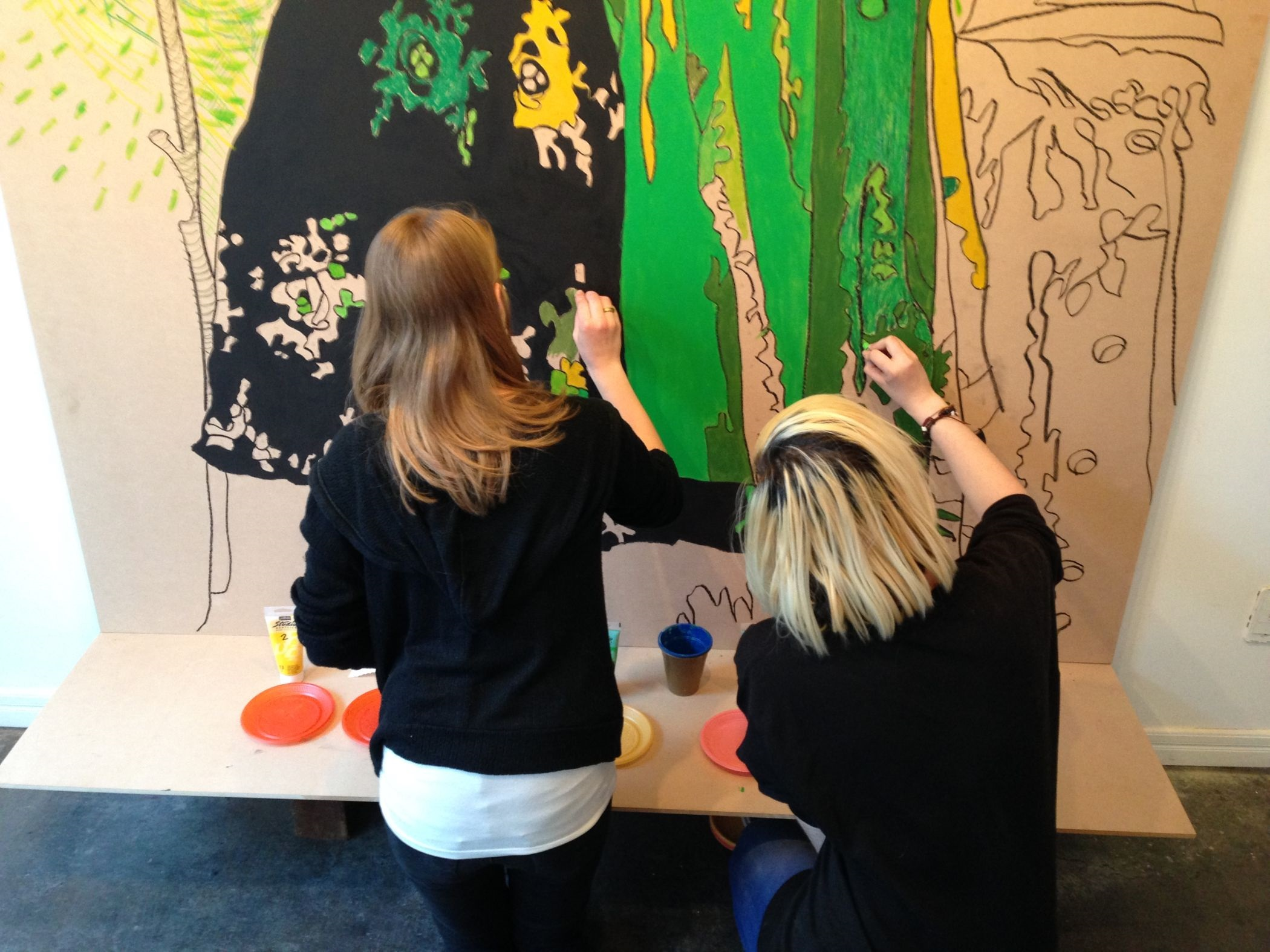 Luise and Lisa work on Biergarten, 2015, 5' x 7', mixed media, photo credit: Mary Jo Karimnia