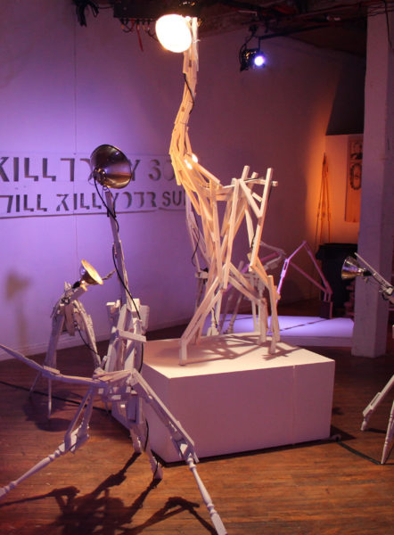 Mike Stasny, YOU KILLED MY SON, NOW I WILL KILL YOUR SUN, 2014, wood, broken furniture, clamp light, paint. Photo courtesy of the artist.